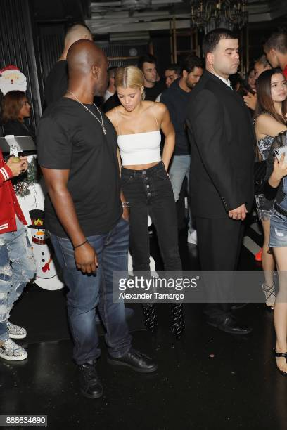 Corey Gamble and Sofia Richie are seen during Art Week Party at Sugar Factory American Brasserie on December 8 2017 in Miami Florida