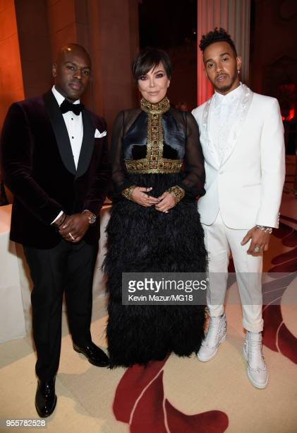 Corey Gamble Kris Jenner and Lewis Hamilton attend the Heavenly Bodies Fashion The Catholic Imagination Costume Institute Gala at The Metropolitan...