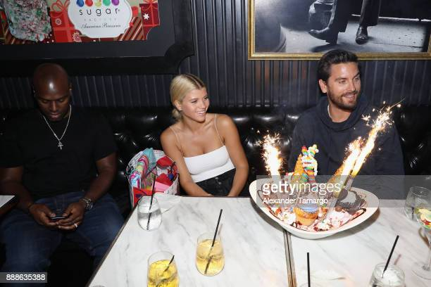 Corey Gamble Sofia Richie and Scott Disick are seen during Art Week Party at Sugar Factory American Brasserie on December 8 2017 in Miami Florida