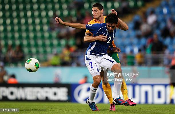 Corey Gameiro of Australia and Olivier Ayala of El Salvador compete for the ball during the FIFA U20 World Cup Group C match between Australia and El...