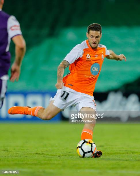 Corey Gameiro of the Brisbane Roar looks to chip the ball over to his player during the round 27 ALeague match between the Perth Glory and the...