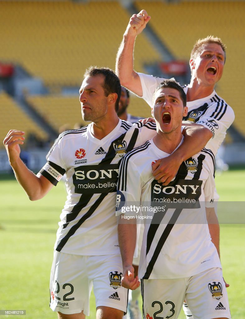 Corey Gameiro (centre) of the Phoenix celebrates his goal with teammates Andrew Durante (L) and Ben Sigmund during the round 22 A-League match between the Wellington Phoenix and Adelaide United at Westpac Stadium on February 24, 2013 in Wellington, New Zealand.