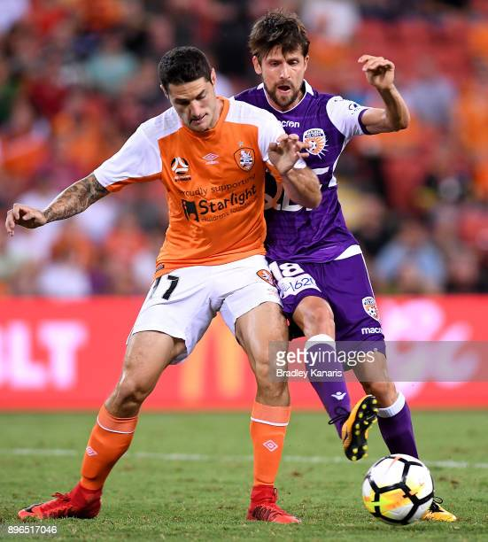 Corey Gameiro of the Roar and Andreu Guerao of the Glory challenge for the ball during the round 11 ALeague match between the Brisbane Roar and the...