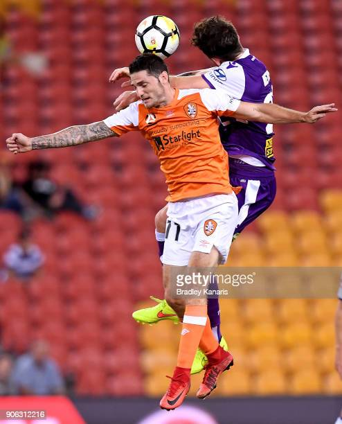 Corey Gameiro of the Roar and Scott Neville of the Glory compete for the ball during the round 17 ALeague match between the Brisbane Roar and the...