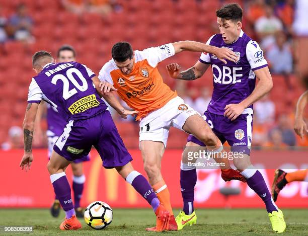 Corey Gameiro of the Roar is pressured by the defence during the round 17 ALeague match between the Brisbane Roar and the Perth Glory at Suncorp...