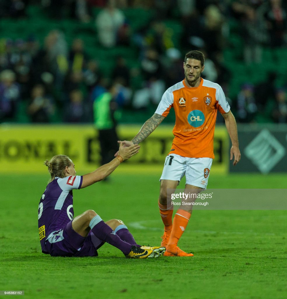 Corey Gameiro of the Roar shakes hands with Joseph Mills of the Glory at the end of the game at nib Stadium on April 14, 2018 in Perth, Australia.