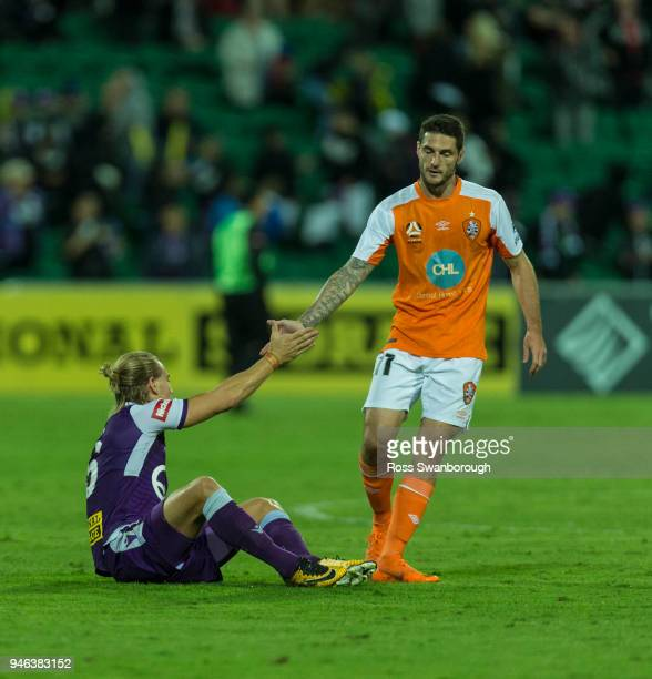 Corey Gameiro of the Roar shakes hands with Joseph Mills of the Glory at the end of the game at nib Stadium on April 14 2018 in Perth Australia