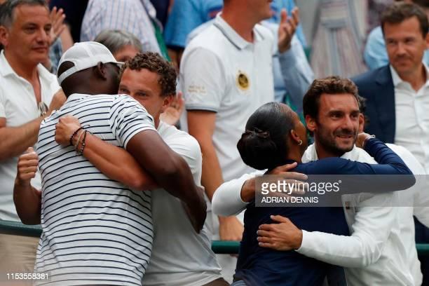 Corey Gauff and Candi Gauff parents of US player Cori Gauff and members of her team celebrate after Guaff beat Slovakia's Magdalena Rybarikova during...