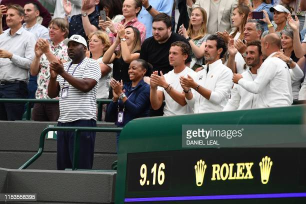 Corey Gauff and Candi Gauff parents of US player Cori Gauff and members of her team including tennis coach Patrick Mouratoglou celebrate after Guaff...