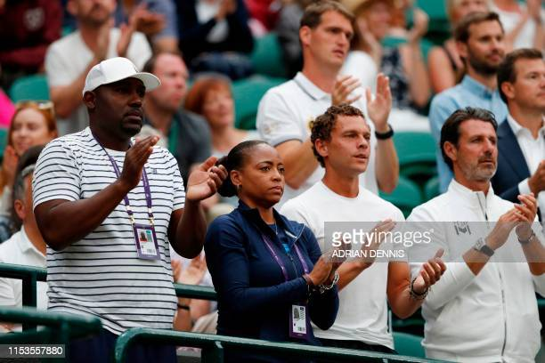 Corey Gauff and Candi Gauff parents of US player Cori Gauff and tennis coach Patrick Mouratoglou cheer as Guaff plays against Slovakia's Magdalena...