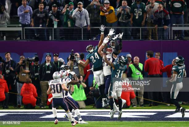 Corey Graham and Jalen Mills of the Philadelphia Eagles go up for a hail mary against Rob Gronkowski of the New England Patriots in the last play of...