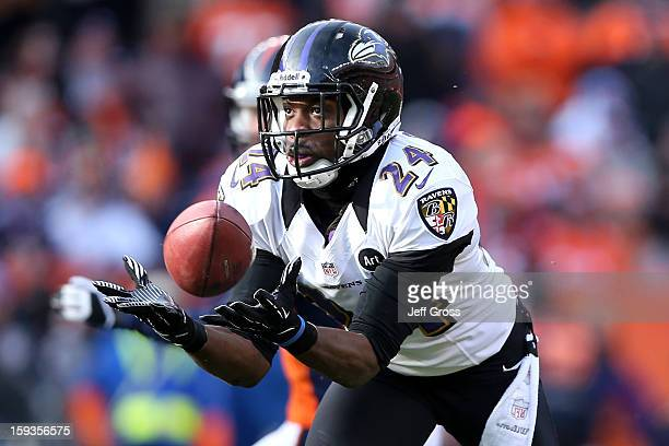 Corey Graham of the Baltimore Ravens intercepts a pass by Peyton Manning of the Denver Broncos which Graham returnd for a 39yard touchdown in the...