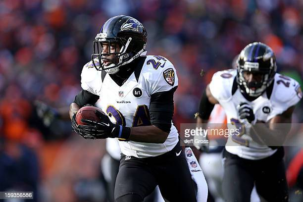 Corey Graham of the Baltimore Ravens returns an interception 39yards for a touchdown in the first quarter against the Denver Broncos during the AFC...