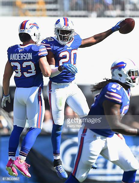 Corey Graham of the Buffalo Bills celebrates a fumble recovery with teammate Colt Anderson in the first quarter of the game against the Los Angeles...