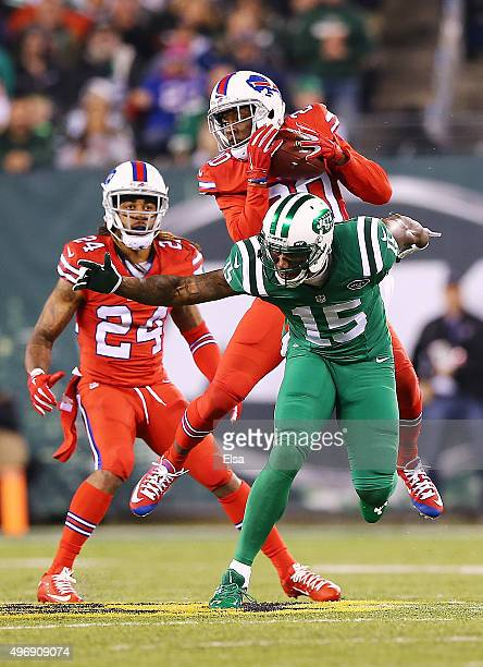 Corey Graham of the Buffalo Bills intercepts a pass intended for Brandon Marshall of the New York Jets during the second quarter at MetLife Stadium...