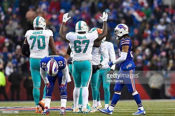 Corey Graham of the Buffalo Bills reacts to Miami Dolphins tying the game in the final seconds to force overtime as Laremy Tunsil of the Miami...