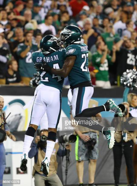 Corey Graham of the Philadelphia Eagles celebrates his interception with Malcolm Jenkins thrown by Kirk Cousins of the Washington Redskins during...