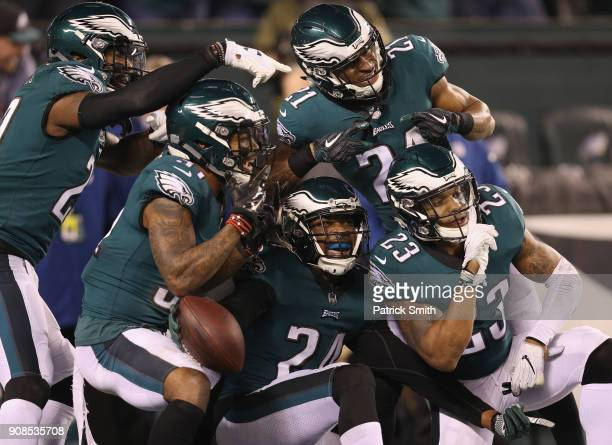 Corey Graham of the Philadelphia Eagles is congratulated by his teammates after getting an interception during the fourth quarter against the...