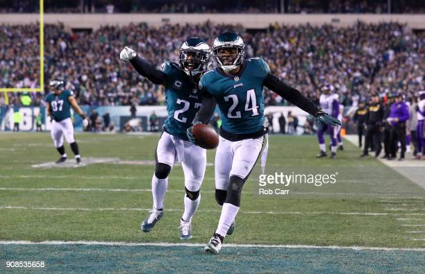Corey Graham of the Philadelphia Eagles is congratulated by his teammate Malcolm Jenkins after getting an interception during the fourth quarter...