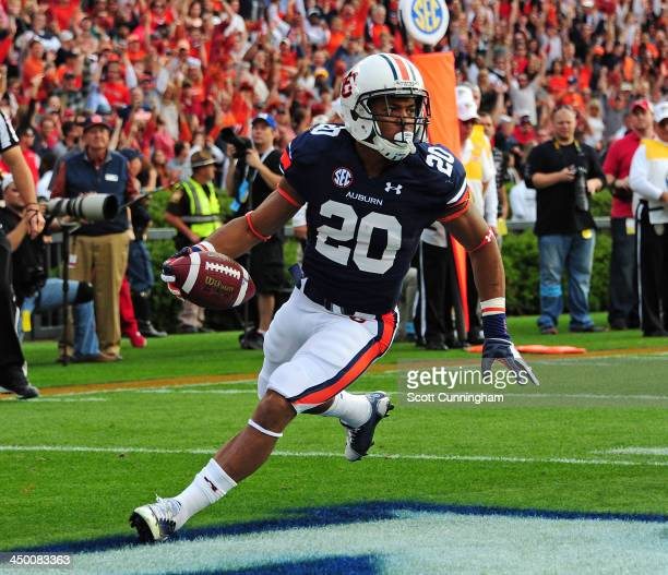 Corey Grant of the Auburn Tigers carries the ball for a touchdown against the Georgia Bulldogs at Jordan-Hare Stadium on November 16, 2013 in Auburn,...