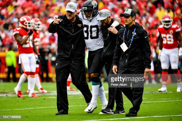 Corey Grant of the Jacksonville Jaguars is helped off the field after an injury during the second quarter of the game against the Kansas City Chiefs...