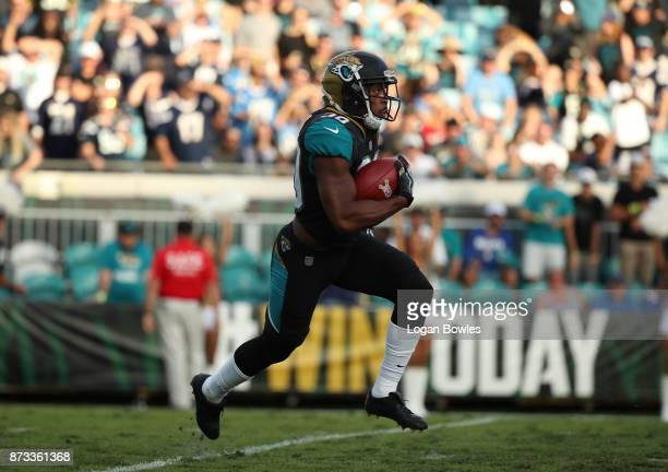 Corey Grant of the Jacksonville Jaguars runs with the football in the second half of their game against the Los Angeles Chargers at EverBank Field on...