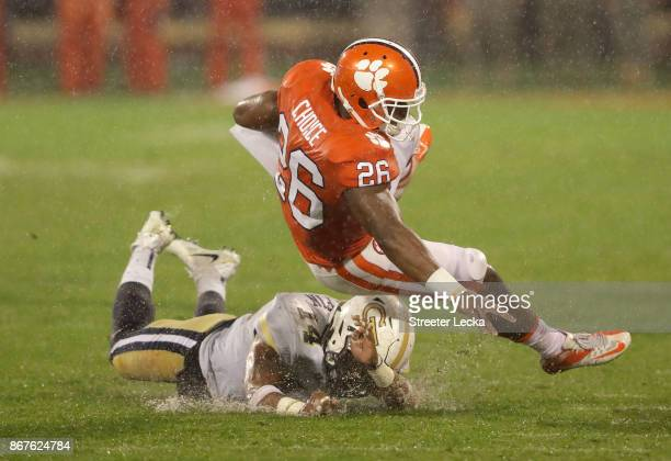 Corey Griffin of the Georgia Tech Yellow Jackets tackles Adam Choice of the Clemson Tigers during their game at Memorial Stadium on October 28 2017...