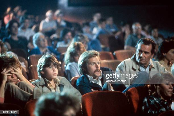 Corey Haim Brian Kerwin and James Garner at the movies in a scene from the film 'Murphy's Romance' 1985