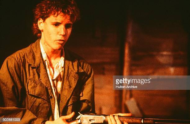 Corey Haim holds a rifle as he is covered in blood in a scene from the Universal Studio movie 'Watchers' circa 1988