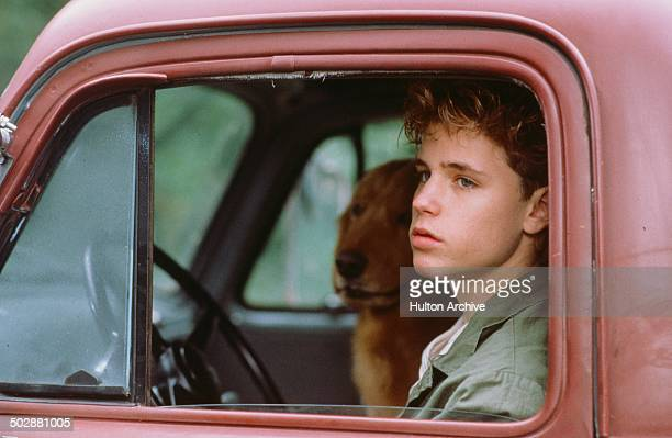 Corey Haim looks on from a pickup truck in a scene from the Universal Studio movie 'Watchers' circa 1988