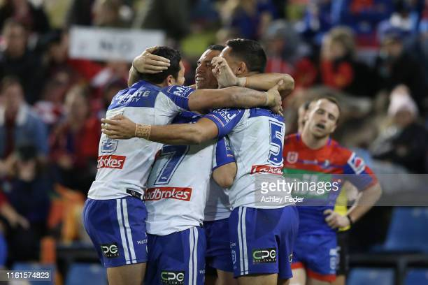 Corey Harawira-Naera of the Bulldogs celebrates his try with team mates during the round 17 NRL match between the Newcastle Knights and the...