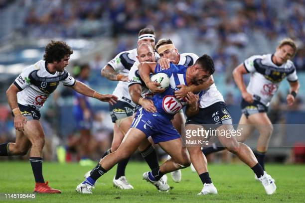 Corey HarawiraNaera of the Bulldogs is tackled during the round 7 NRL match between the Canterbury Bulldogs and the North Queensland Cowboys at ANZ...