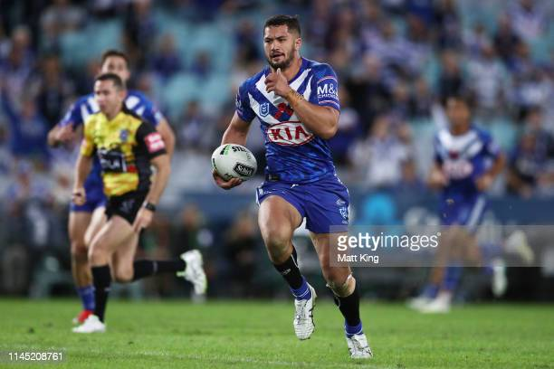 Corey HarawiraNaera of the Bulldogs makes a break to score a try during the round 7 NRL match between the Canterbury Bulldogs and the North...