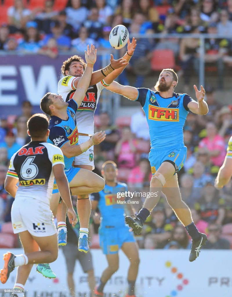 Corey Harawira-Naera of the Panthers and Ryan Simpkins of the Titans go up for a high ball during the round six NRL match between the Penrith Panthers and the Gold Coast Titans on April 15, 2018 in Penrith, Australia.