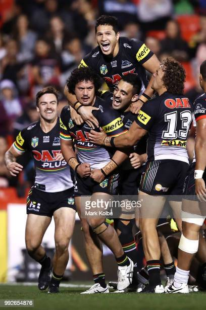Corey HarawiraNaera of the Panthers celebrates with his team mates after scoring a try during the round 17 NRL match between the Penrith Panthers and...