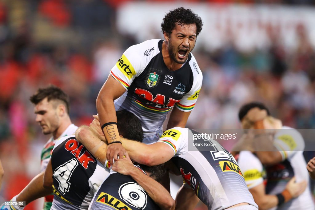 Corey Harawira-Naera of the Panthers jumps on his team mates as they celebrate Tyrone Peachey of the Panthers scoring a try during the round two NRL match between the Penrith Panthers and the South Sydney Rabbitohs at Penrith Stadium on March 17, 2018 in Sydney, Australia.