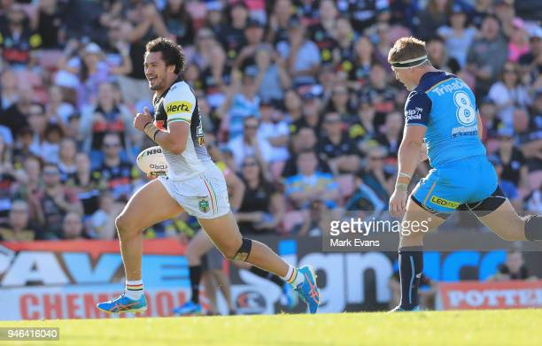 Corey HarawiraNaera of the Panthers runs with the ball to score a try during the round six NRL match between the Penrith Panthers and the Gold Coast...