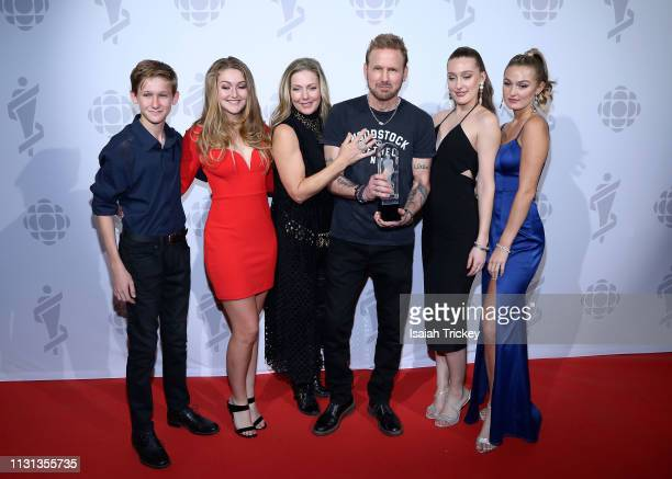 Corey Hart and family pose in the winners room during the 2019 Juno Awards at London Convention Centre on March 17 2019 in London Canada