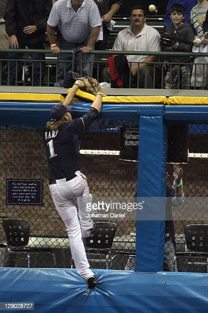 Corey Hart of the Milwaukee Brewers can't make a play on a solo home run hit by David Freese of the St. Louis Cardinals in the top of the ninth...