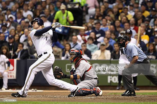 Corey Hart of the Milwaukee Brewers hits a solo home run in the bottom of the first inning against the St Louis Cardinals during Game Six of the...