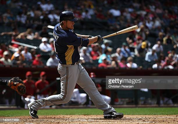 Corey Hart of the Milwaukee Brewers hits a tworun home run against the Arizona Diamondbacks during the fourth inning of the spring training game at...