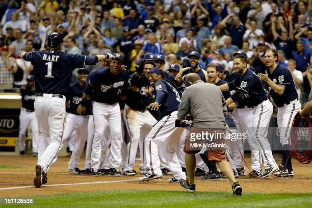 Corey Hart of the Milwaukee Brewers is awaited by the team at home plate after hitting a walk off home run in the bottom of the 9th inning putting...