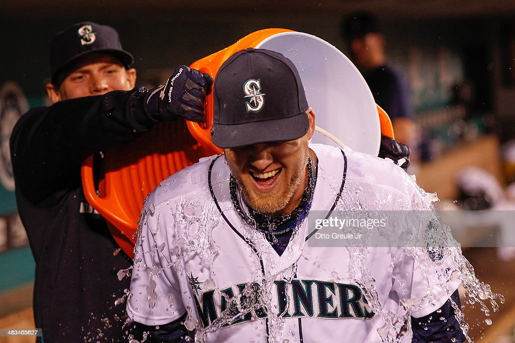 Corey Hart #27 of the Seattle Mariners is doused with water after the game against the Los Angeles Angels of Anaheim on Opening Day at Safeco Field on April 8, 2014 in Seattle, Washington. Hart had two home runs in the 5-3 win.