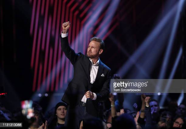 Corey Hart reacts after being inducted into the Canadian Music Hall of Fame during the 2019 Juno Awards at Budweiser Gardens on March 17 2019 in...