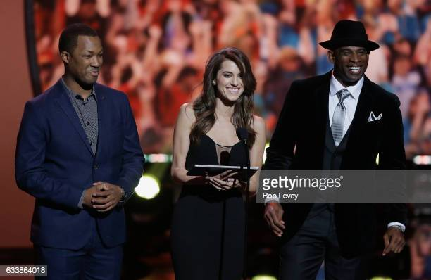 Corey Hawkins Allison Williams and Deion Sanders from left present the AP Coach of the Year Award during the NFL HONORS at the Wortham Theater Center...