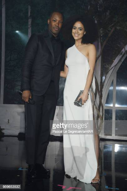 Corey Hawkins and Laura Harrier speak on stage at amfAR Gala Cannes 2018 dinner at Hotel du CapEdenRoc on May 17 2018 in Cap d'Antibes France