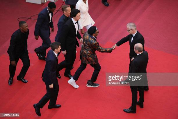 Corey Hawkins John David Washington Jasper Paakkonen Adam Driver and Topher Grace walk towards Director Spike Lee as he is greeted by Cannes Film...