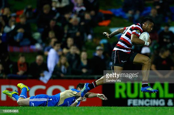 Corey Jane of the All Blacks misses the tackle of Frank Halai of Counties Manukau during a New Zealand All Blacks training match between Counties...