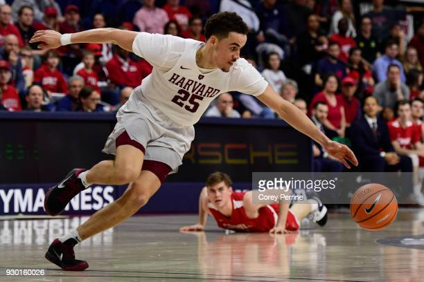 Corey Johnson of the Harvard Crimson beats out Stone Gettings of the Cornell Big Red for the ball during the second half of a semifinal round matchup...