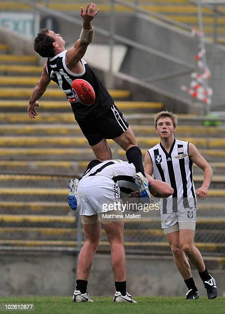 Corey Jones of North Ballarat flies early injuring Kris Pendlebury of Collingwood during the round 11 VFL match between Collingwood and North...